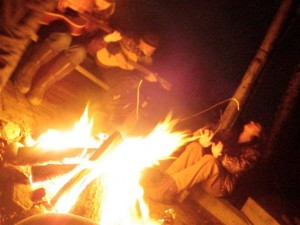 Playing music to pass the time around the fire - photo by Kjersti Vick - March 29, 2010