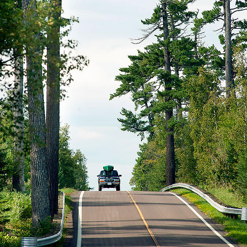 Scenic-Drives_Summer-Gunflint-Trail-MN-Outdoor-Elbow-Lake-turn-off-with-canoe-truck-LayneKennedy-CCVB_CC-1