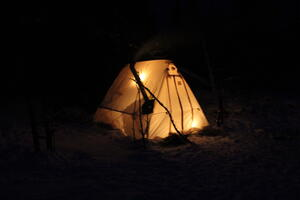 Cozy glow of a warm tent in the BWCAW